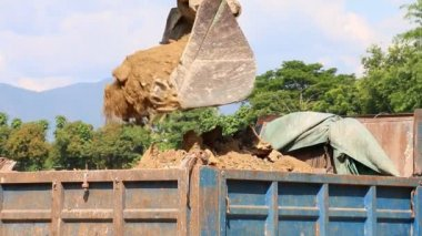 Backhoe Working Dump Soil To Truck Car — Stock Video