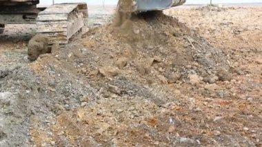 Backhoe Working Scoop Soil In Construction Site — Stock Video