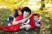Family on autumn walk — Stock Photo
