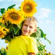 Childhood in the sunflowers — Stock Photo #69362847