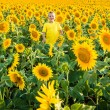 Childhood in the sunflowers — Stock Photo #69374627