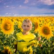 Childhood in the sunflowers — Stock Photo #69374713