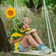 Childhood in the sunflowers — Stock Photo #70174713