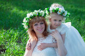 Mom and daughter in the spring outing — Stock Photo