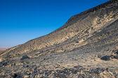 Black desert lanscape and basalt formarions — Stock Photo