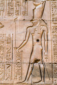 Egyptian hieroglyphs on the wall in a temple — ストック写真