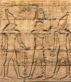 Egyptian hieroglyphs on the wall in a temple — Foto Stock