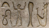 Egyptian hieroglyphs on the wall in a temple — Foto de Stock