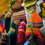 Warm knitted hats on autumn fair — Stock Photo #77595206