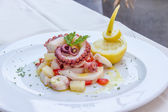 Appetizer of cuttlefish octopus and potatoes — Stock Photo