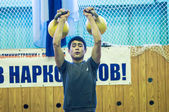 The boy in the kettlebell sport — 图库照片