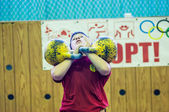 The boy in the kettlebell sport — Stockfoto