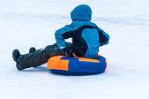 Baby winter sledding on the Ural River. — Stock Photo