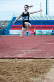 Girl performs a long jump — Stock Photo