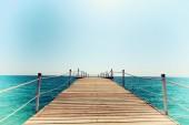 Pier in blue sea vintage toning — Stock Photo