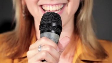 Singing at microphone in music studio — Stock Video