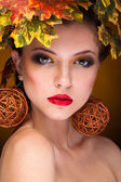 Gorgeous girl with autumn make up and leaves — Stock Photo