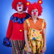 Clown couple in costumes on blue background — Stock Photo #54776955