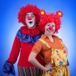 Clown couple in costumes on blue background — Stock Photo #54776967