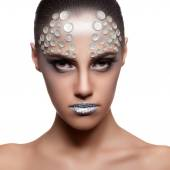 Beautiful brunette model with rhinestone fashion make up — Stock Photo