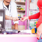 Customer paying with credit card at doctor — Stock Photo