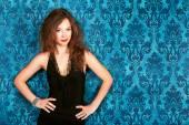 Brunette model posing against blue vintage wall smiling fashion  — Stok fotoğraf