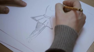 Men drawing sketches on a sheet of paper — Stock Video