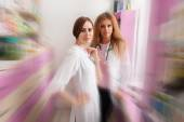 Two nurses at the pharmacy desk — Stock Photo