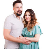 Pregnant woman with her husband isolated on white background — Stock Photo