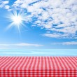 Empty wooden deck table with tablecloth for product montage texture background wallpaper. — Stock Photo #52142987