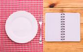 Cutlery red checkered tablecloth tartan on  wooden table top view. — Stock Photo