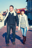 Young couple walking around city in winter. — Photo