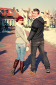 Young couple walking around city in winter. — Foto Stock