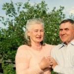 Happy and smiling senior couple. Elderly couple walking. — Stock Photo #57006455