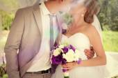 Wedding couple bride and groom holding hands. — Stock Photo