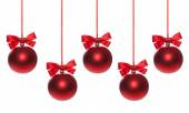 Red baubles on Christmas tree — Stockfoto