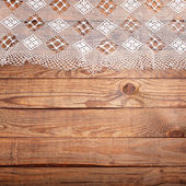Wood texture, wooden table with white lace tablecloth top view. — Foto de Stock