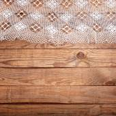 Wood texture, wooden table with white lace tablecloth top view. — Stock Photo