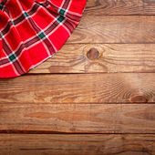 Wood texture, wooden table with red tablecloth tartan top view. — Fotografia Stock