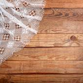 Wood texture, wooden table with white lace tablecloth top view. — Foto Stock