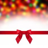 Red satin ribbon and bow close up isolated — Stock Photo
