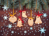 Christmas cookies handmade lies on wooden background. — Stock Photo