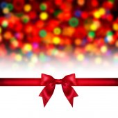 Red ribbon bow on holidays background. — Photo