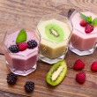 Drink smoothies four summer strawberry, blackberry, kiwi, raspberry on wooden table. — Stock Photo #61804167