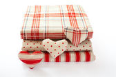 Linen fabric with red polka dots, plaid and stripes for needlework stacked in pile isolated. — Stock Photo