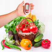 Vegetables isolated on white. Woman testing for high blood sugar. — Stock Photo