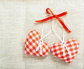 Heart made of cloth in red cell handmade Valentines Day — Stock Photo