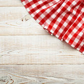 Top view of checkered tablecloth on white wooden table. — Stok fotoğraf