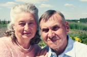 Senior couple embracing each other in countryside — Stock Photo