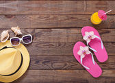 Trendy summer accessories on wooden background pool. — Stock Photo